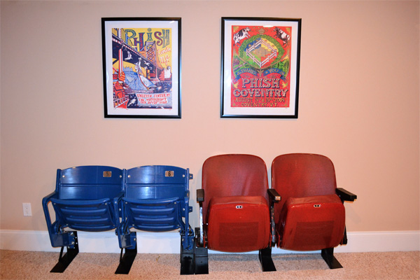 Kase's husband's stadium seating and concert posters