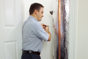 Man maintaining a home water heater