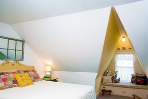 Window seat in attic bedroom