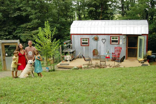 The Berzins family outside their tiny home