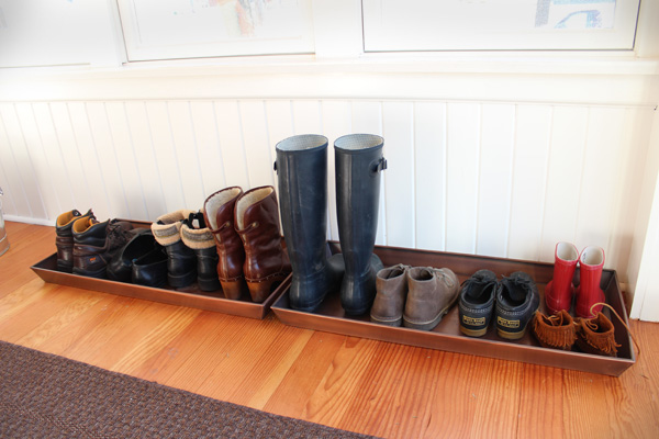 Winter boot drying rack in a home entryway