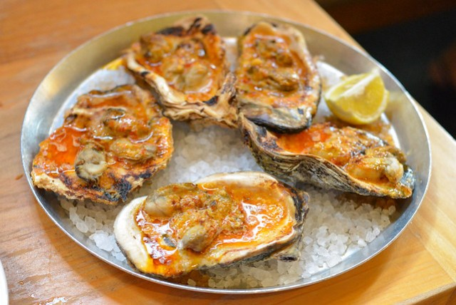 wood-fired oysters with chili garlic butter