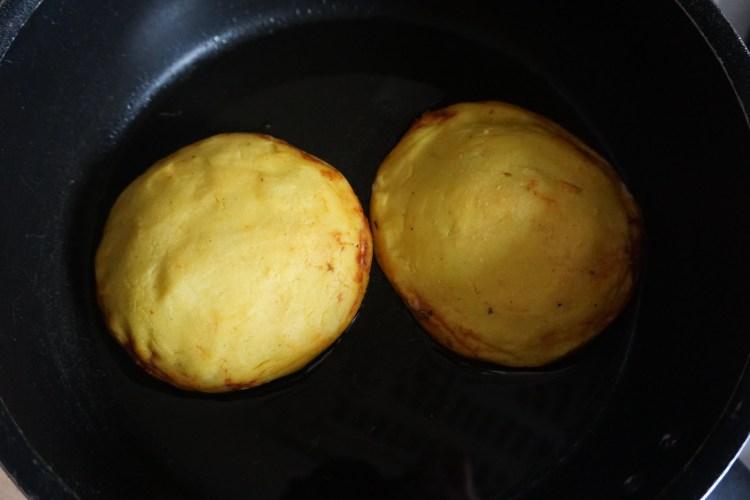 Gluten free hot pocket arepas being pan fried