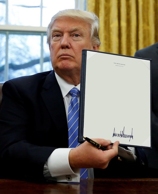 Donald Trump Likes to Sign Things