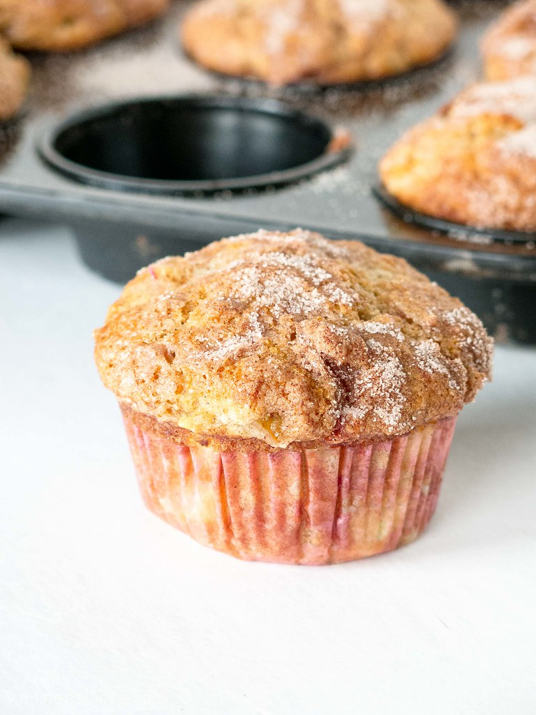 Rhubard Muffins with Greek Yogurt with a tray of muffins in the background