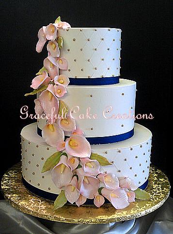 Elegant Ivory Butter Cream Wedding Cake With Gold Sugar Pe