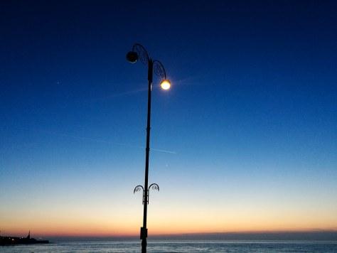 Streetlamp star and ocean