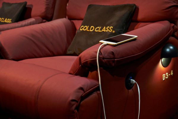 You can charge your smartphone or tablet device while you watch your movie. Credit: Golden Village
