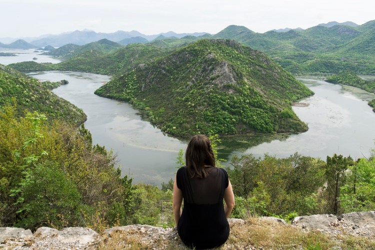 Sitting by the edge of a cliff overlooking Crnojevica River in Lake Skadar national Park | Montenegro | My gluten free experience in Montenegro