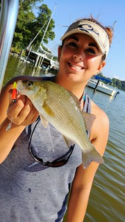 Photo of Woman holding white perch she caught