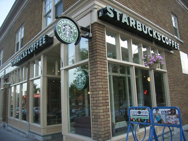 The Starbucks Coffee Shop At The Corner Of Bank And Hopewe