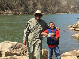 Photo of Grandfather and grandson with shad