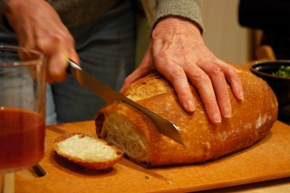 Breaking bread, juice, dinner party, Broadview townhouse, Seattle, Washington, USA