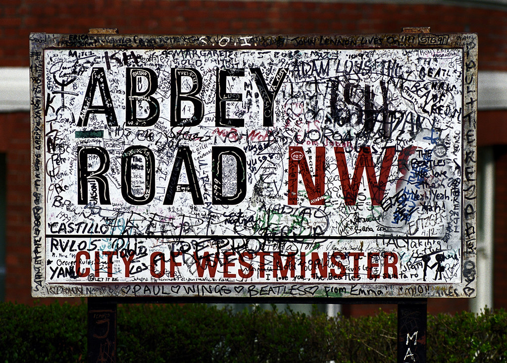 Graffiti covered Abbey Road street sign, London (photographed in 2000.