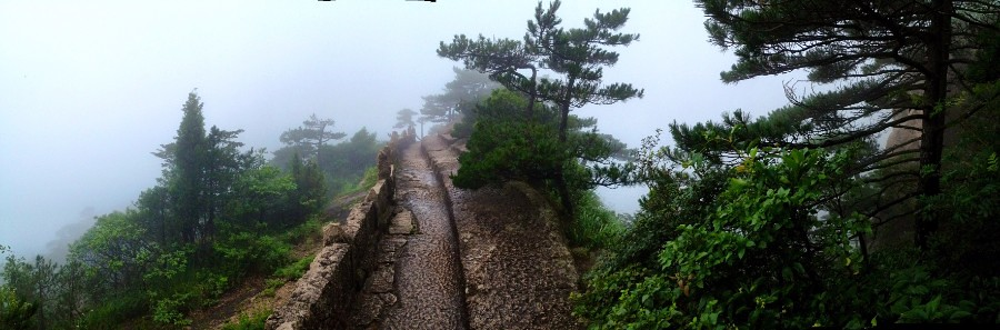trail on huangshan mountain in china dipped in mist