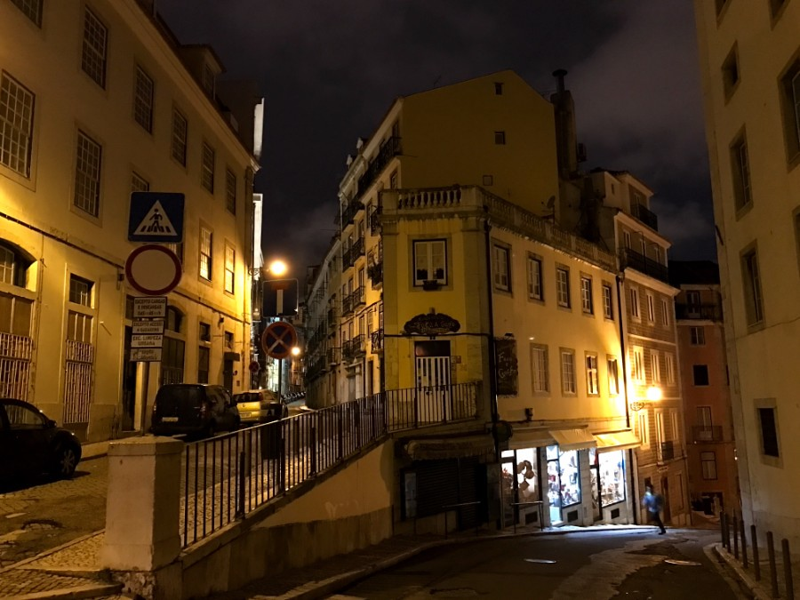 narrow uneven streets of lisbon at night