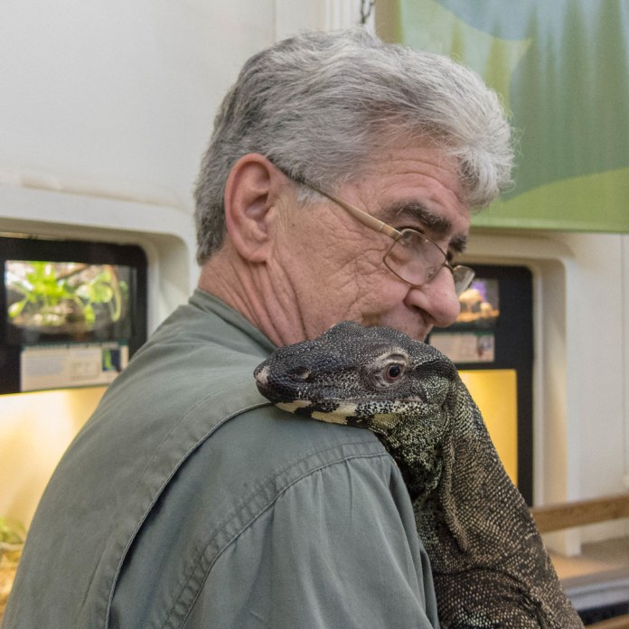 Dude with monitor lizard