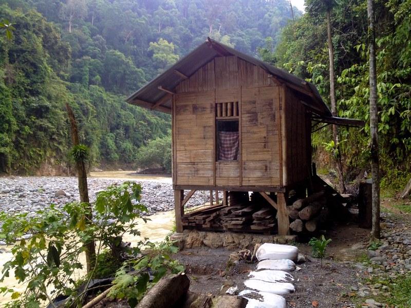 little wooden hut by river in bukit lawang