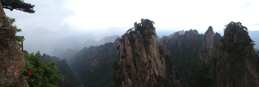 panoramic view of dramatic mountain formations in huangshan, china