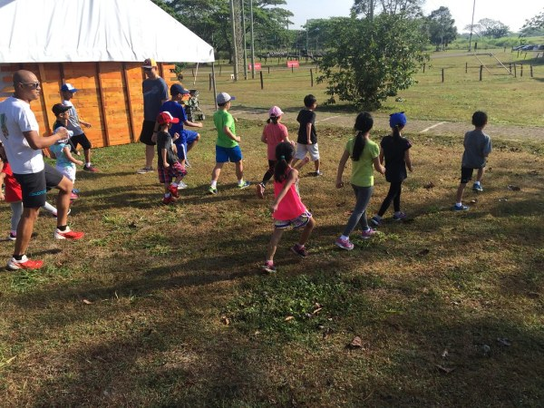Coach Ige leads the kids in Nuun Dirt Pre-school