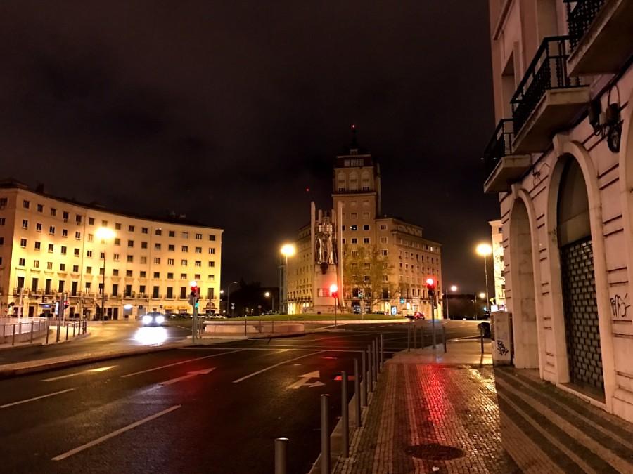 lisbon wet streets at night