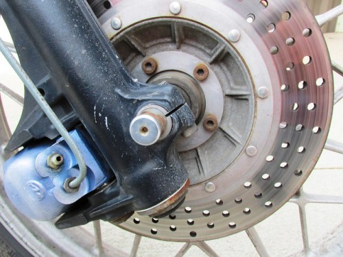 Steel Brake Line Attaches To Bottom Hole on Brake Caliper