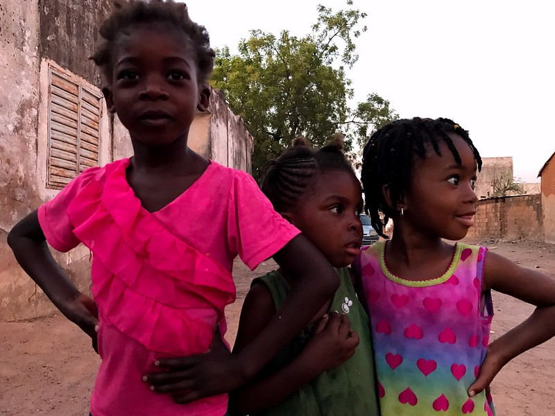 three girls on colorful clothes in tabacounda, senegal