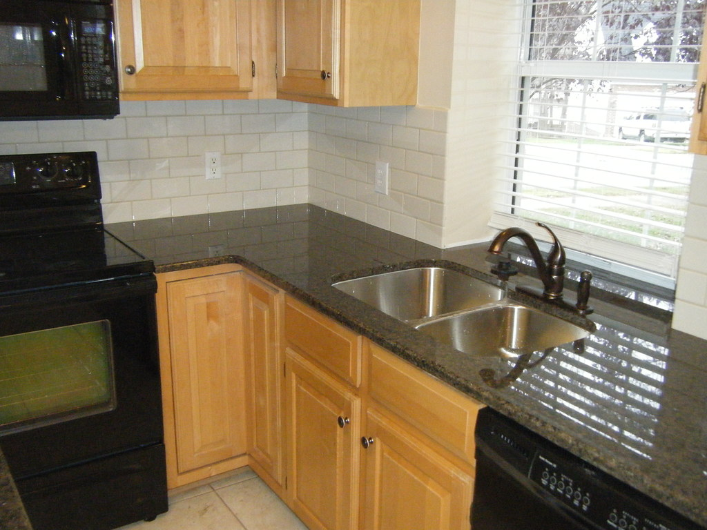 Tropic Brown Granite Counter top with Tile Backsplash   Flickr on Backsplash:gjexfbx4_Ly= Black Granite Countertops  id=32139