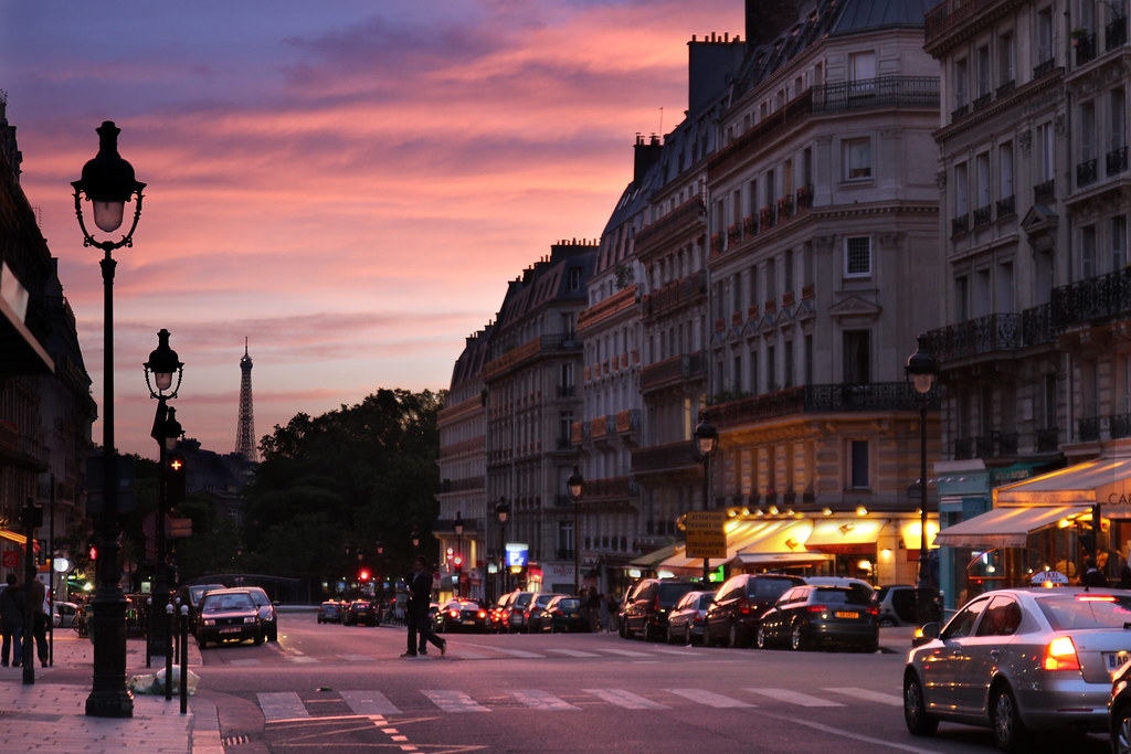 Paris Sunset The Eiffel Tower Can Be Seen In The