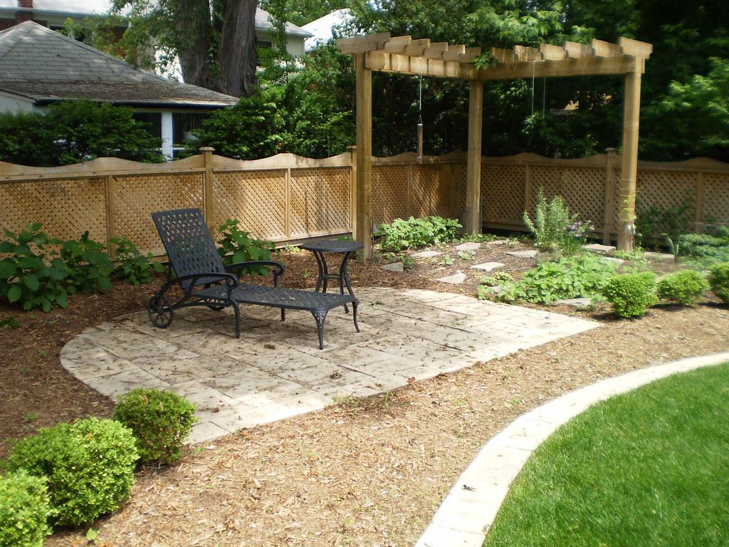 Backyard Landscape Ideas | A backyard oasis was created in ... on Economical Patio Ideas  id=97929