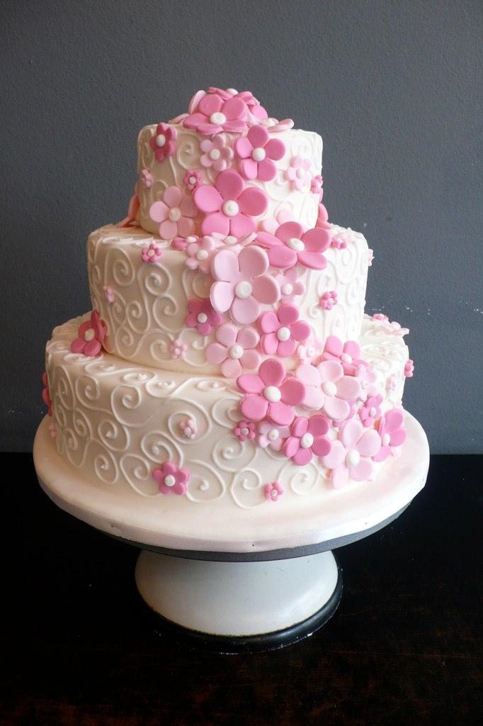White Fondant Wedding Cake With Roses Amp Swirls This