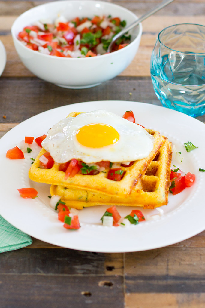 Cornmeal cheddar chipotle waffles with salsa and fried egg.