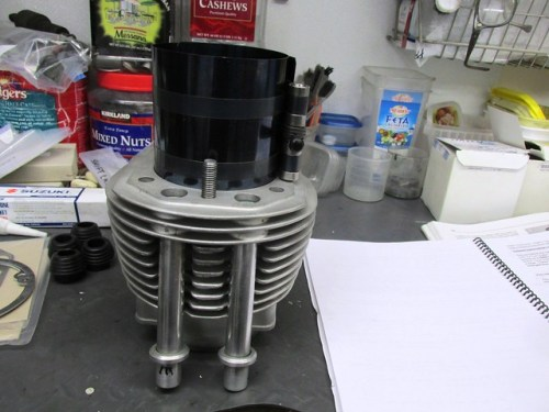 Piston in Ring Compressor on Top of Cylinder