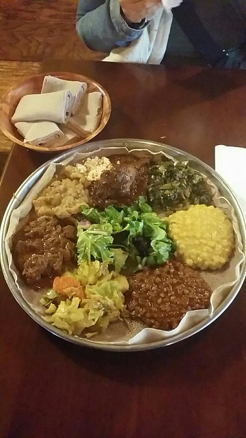 Veggie and meat combo platter with injera