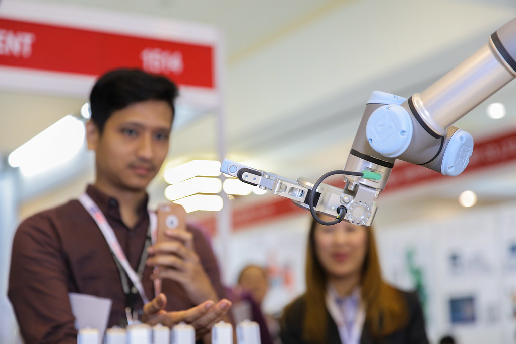 The Cobot can be program into many forms of task such a passing a flash drive into visitor's hand.