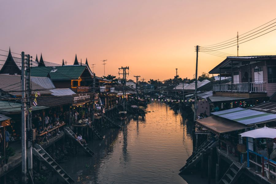The Amphawa floating market in Samut Songkhram province, Thailand is a must-see destination for its food and natural beauty.