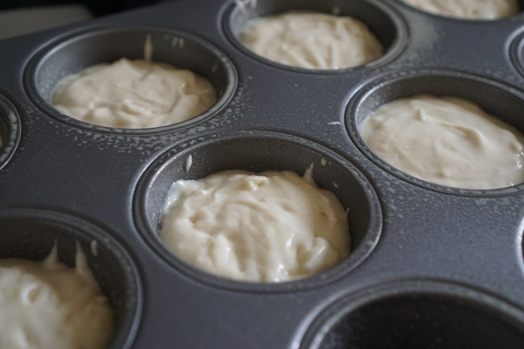 Baked gluten free crumpets making process | batter poured into muffin tin