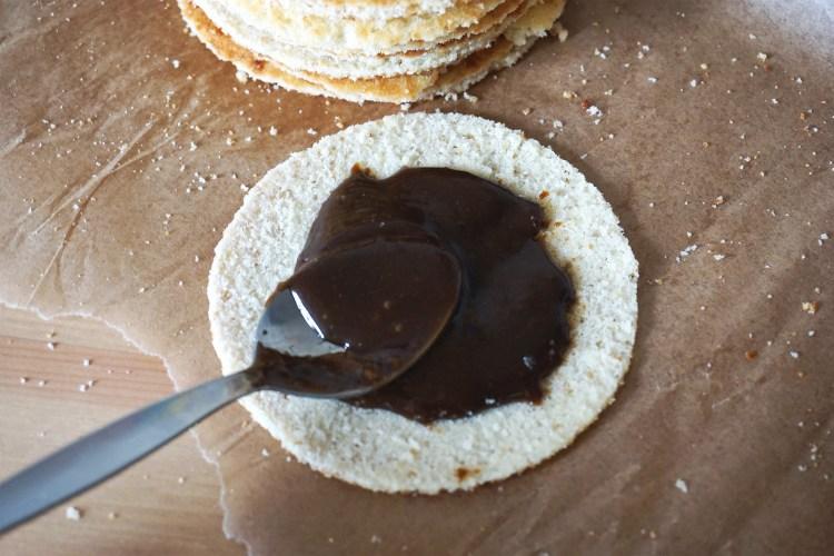 Gluten free Dutch waffles (stroopwafels) making process | spreading the caramel filling