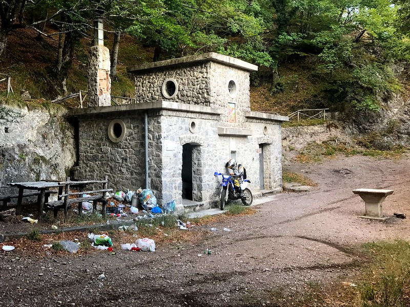 a yamaha wrf motorbike in front of stone hut by the foot of pizzo san michelle in the picentini mountains in italy