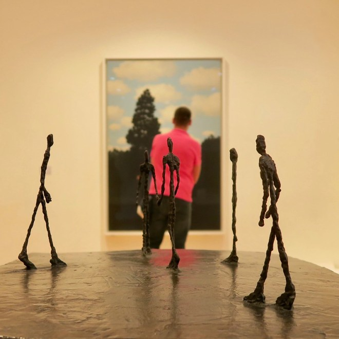 Giacometti Men on Red Shirt and Magritte