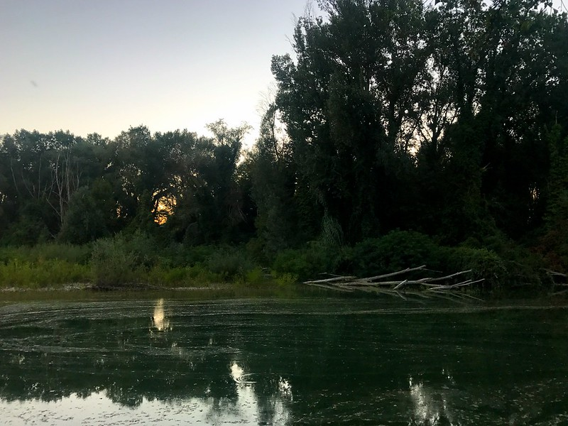 dusk over metauro river in marche italy - cycling in italy