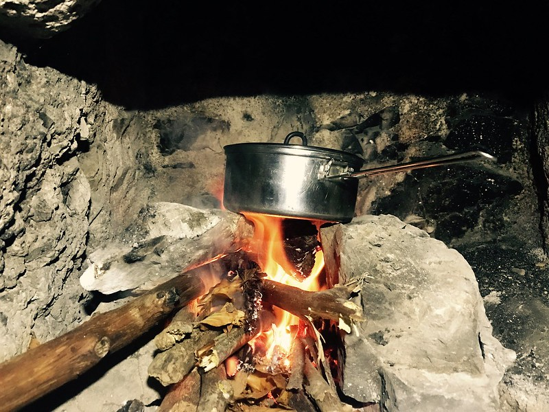 saucepan lying on the fire in fireplace in stone mountain refuge in monti picentini near napoli
