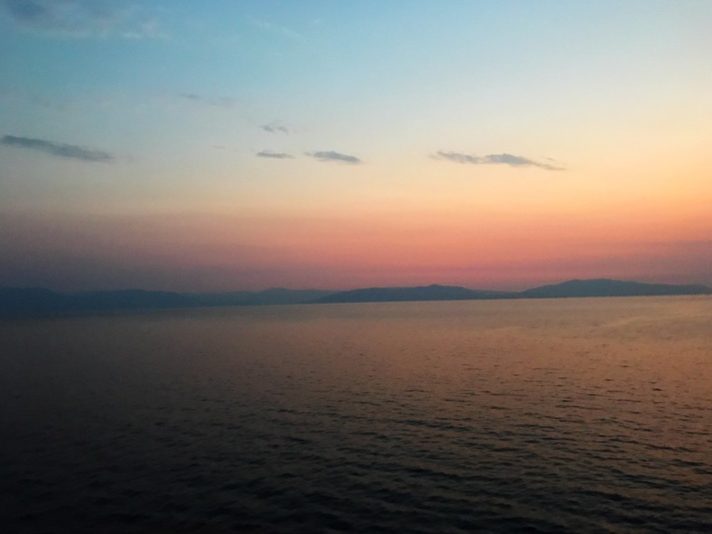 red dusk sky over the gulf of achaea in greece