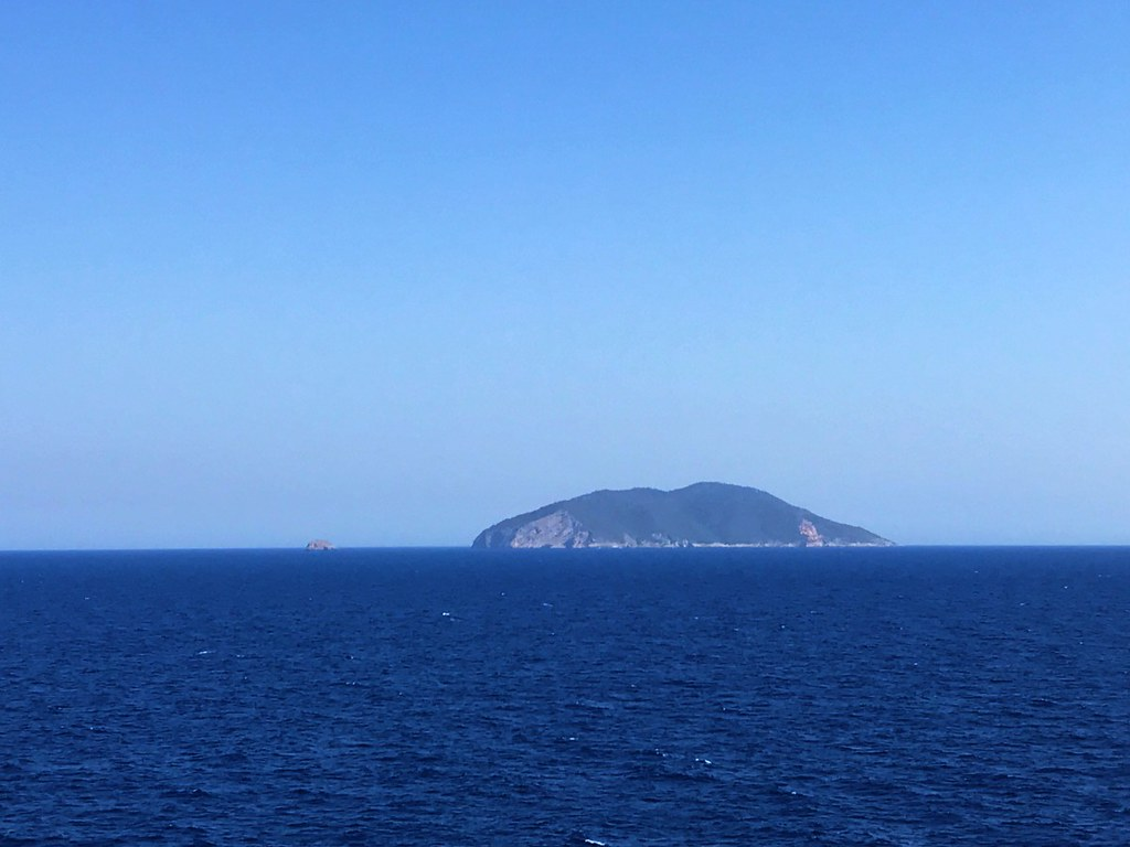 view of a croatian island from the boat from greece to italy