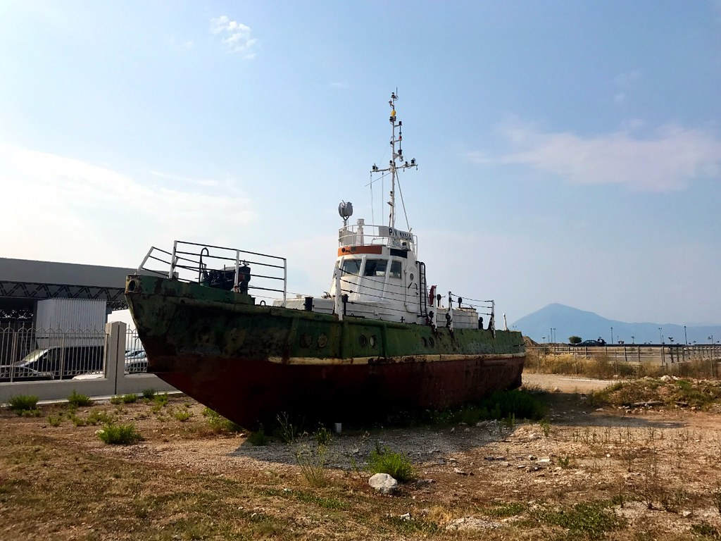 old boat on land in patras, greece