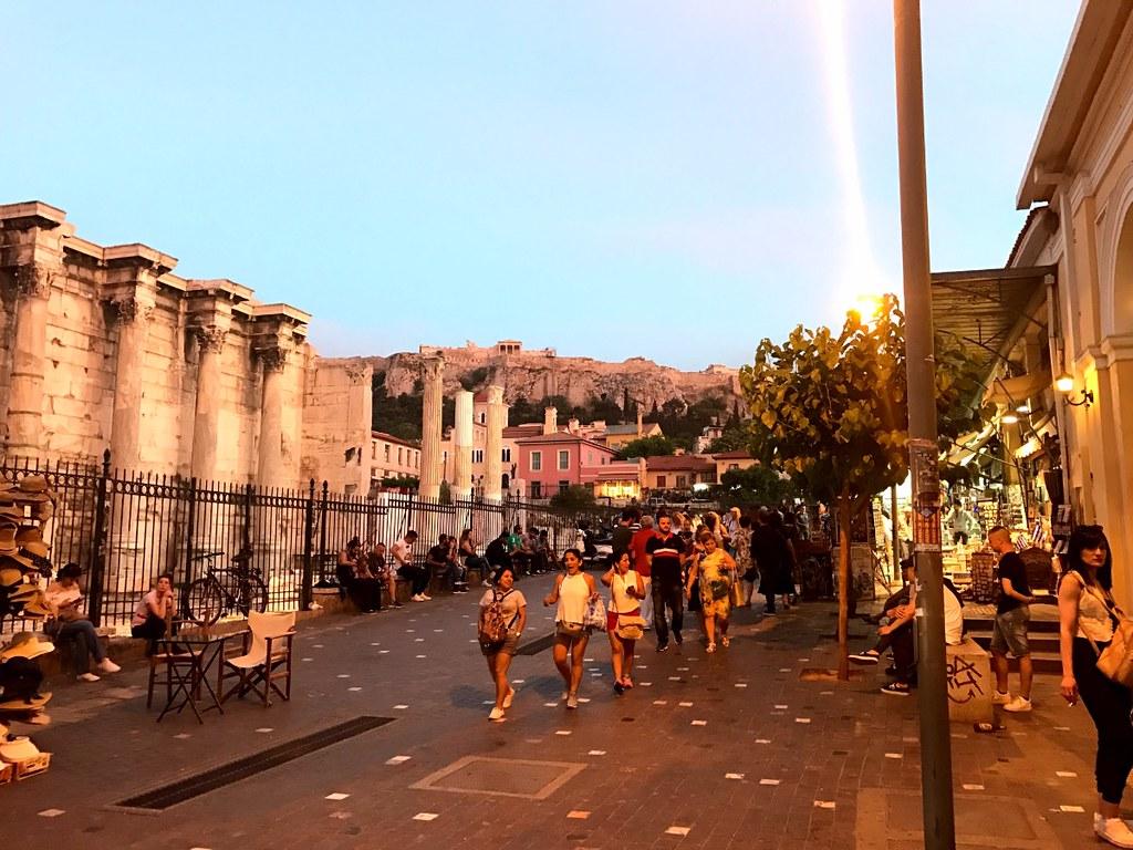 tourists walking under acropolis in monastiraki athens
