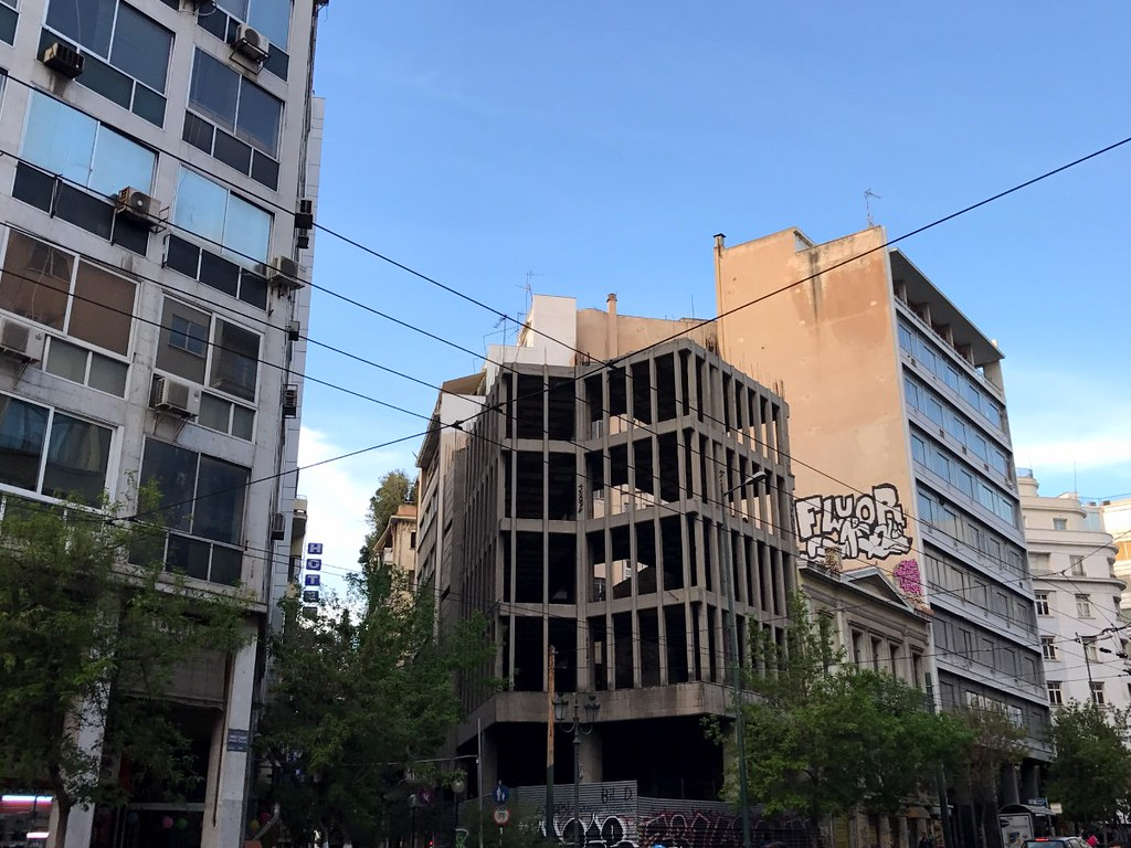 unfinished concrete building in athens