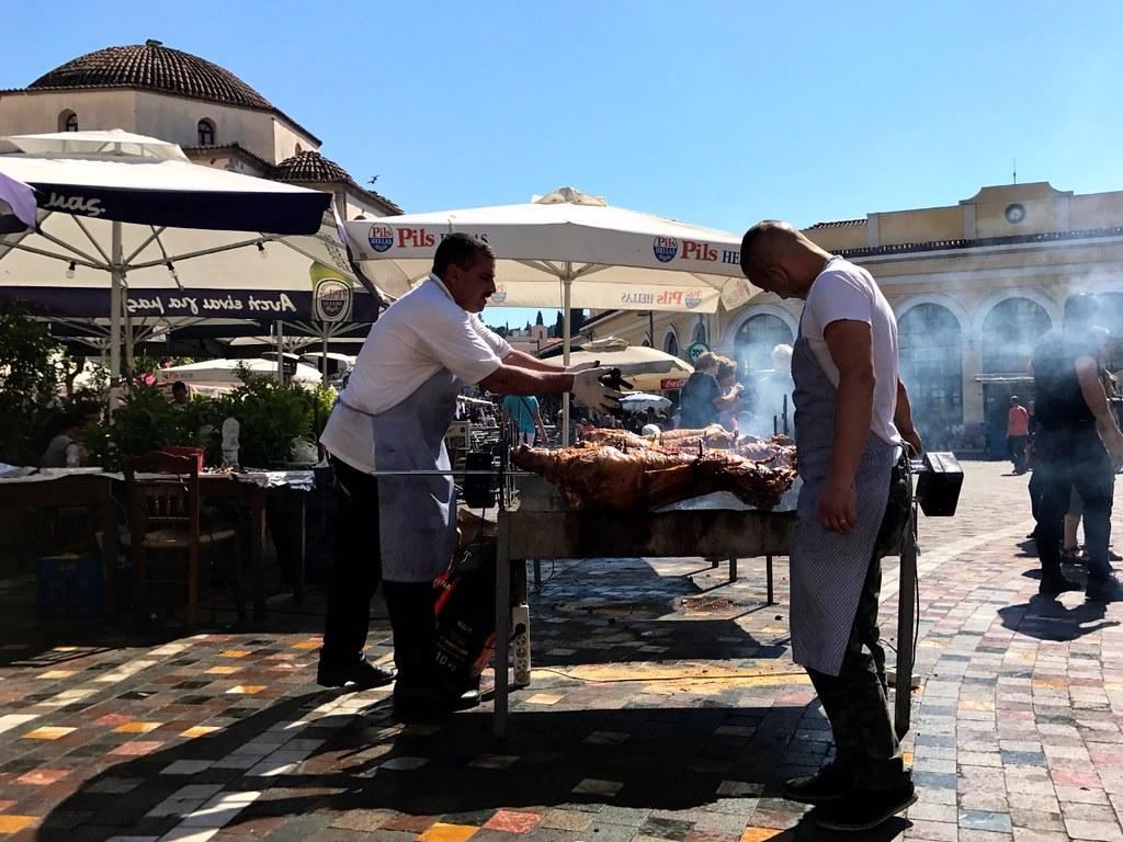 greek men preparing lamb for easter in monastiraki square