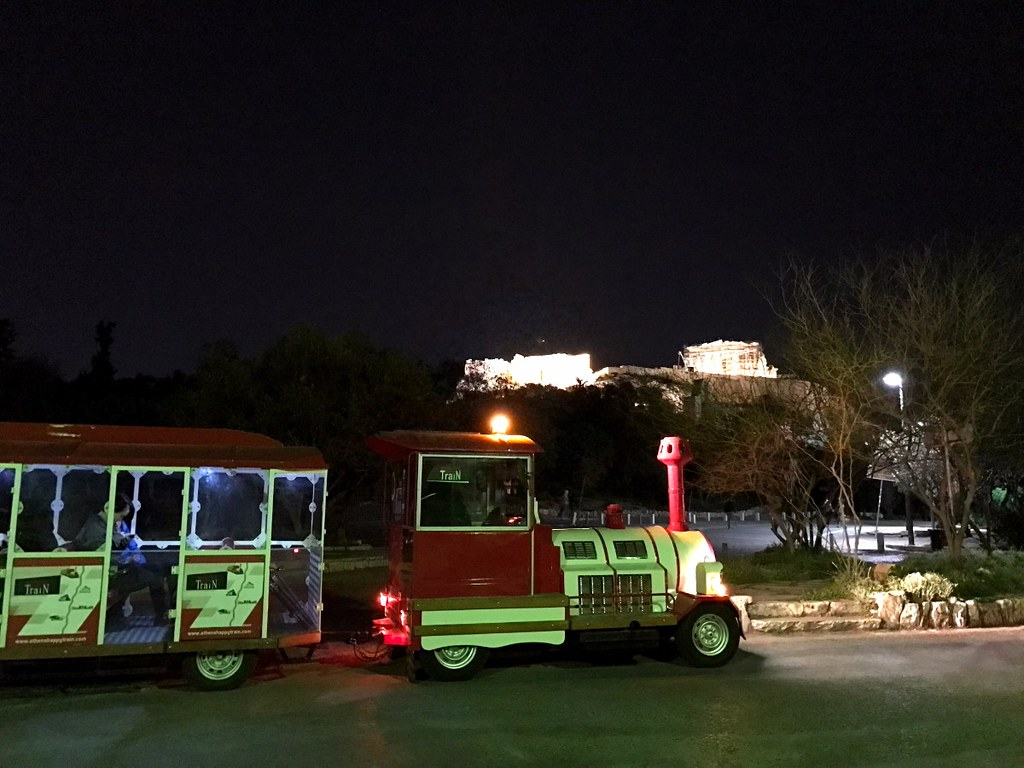 athens touristic train in front of acropolis
