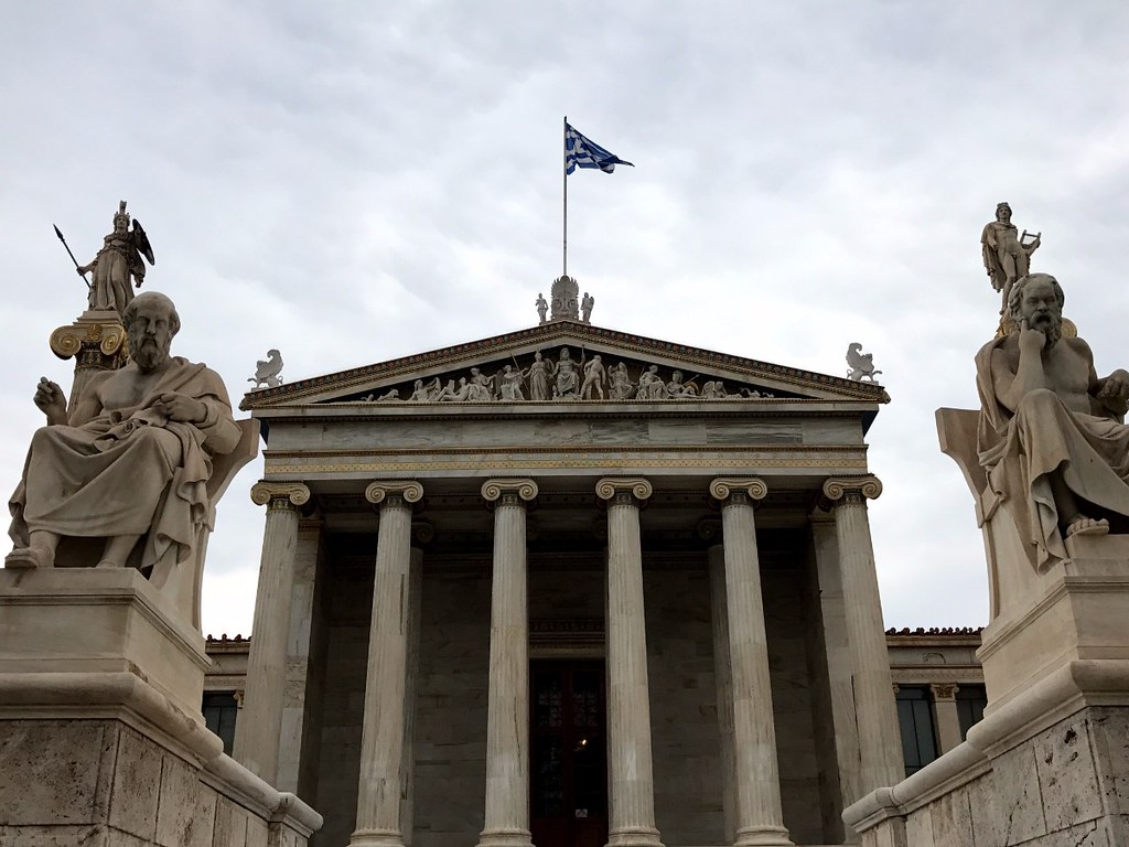 statues of athena, apollo, plato and socrates in front of athens university